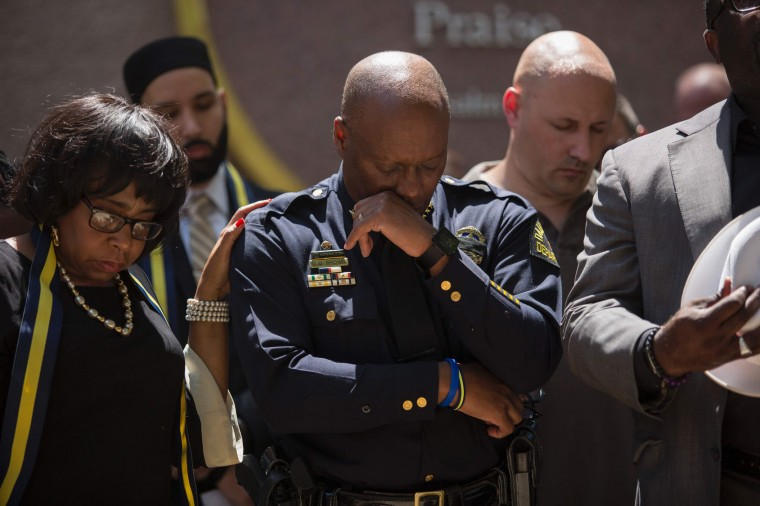 Dallas Police Chief David Brown prays during a a vigil at Thanks-Giving square in Dallas on July 8, 2016, following the shootings during a peaceful protest on July 7 which left 5 police officers dead. (Laura Buckman/AFP/Getty Images)