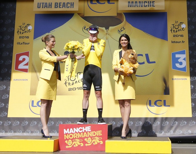 Britain's sprinter Mark Cavendish kisses the overall leader's yellow jersey after the first stage of the Tour de France cycling race over 188 kilometers (116.8 miles) with start in Mont-Saint-Michel and finish in Utah Beach, France, Saturday, July 2, 2016. (AP Photo/Christophe Ena)