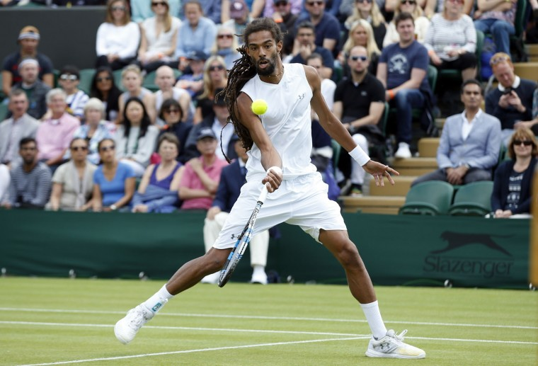 Dustin Brown of Germany returns to Nick Kyrgios of Australia during their men's singles match on day five of the Wimbledon Tennis Championships in London, Friday, July 1, 2016. (AP Photo/Alastair Grant)