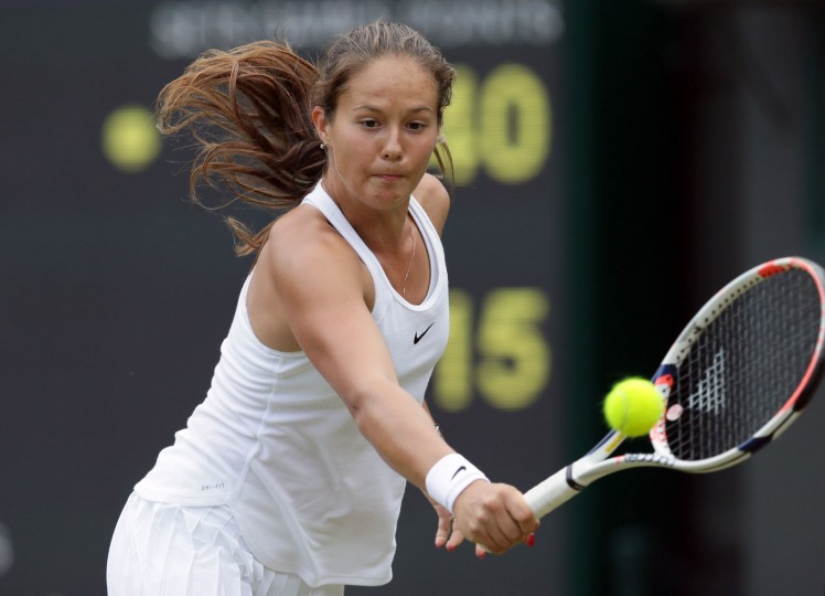 Daria Kasatkina of Russia plays a return to Venus Williams of the US during their women's singles match on day five of the Wimbledon Tennis Championships in London, Friday, July 1, 2016. (AP Photo/Tim Ireland)