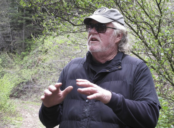 In this May 23, 2016 photo, David Milarch, a Michigan nurseryman and co-founder of Archangel Ancient Tree Archive, is interviewed in the southern Sierra Nevada near Camp Nelson, Calif. Milarch runs the nonprofit group that collects genetic samples from ancient trees and clones them in a lab to be planted in the forest. He believes the giant sequoias and coastal redwoods are blessed with some of the heartiest genetics of any trees on earth and that propagating them will help reverse climate change. (AP Photo/Scott Smith)