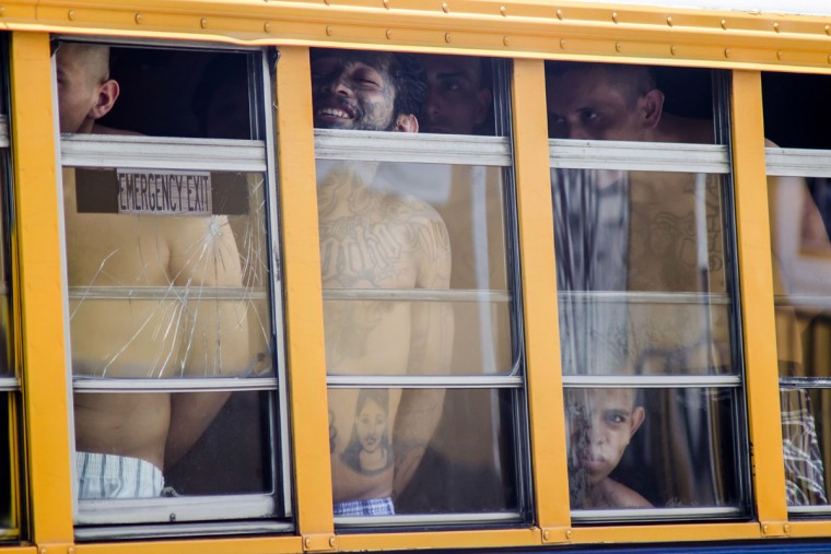 Inmates ride in a bus out of the Cojutepeque prison in El Salvador, Thursday, June 16, 2016. This prison, which houses more than a thousand 18th street imprisoned gang members, will be closed down by the government, since it has been unable to prevent the amount of illegal activities happening inside the prison walls. Inmates will be relocated to other medium-security prisons. (AP Photo/Salvador Melendez)