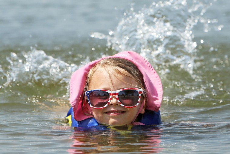"Brooklyn Kazda, 5, floats in the water during a trip to Tenney Beach on Lake Mendota in Madison, Wis., Thursday, July 21, 2016. The high pressure system, sometimes called a ""heat dome,"" will push conditions to their hottest point so far this summer, though record hot temperatures are not expected, according to the National Weather Service. (Amber Arnold/Wisconsin State Journal via AP)"