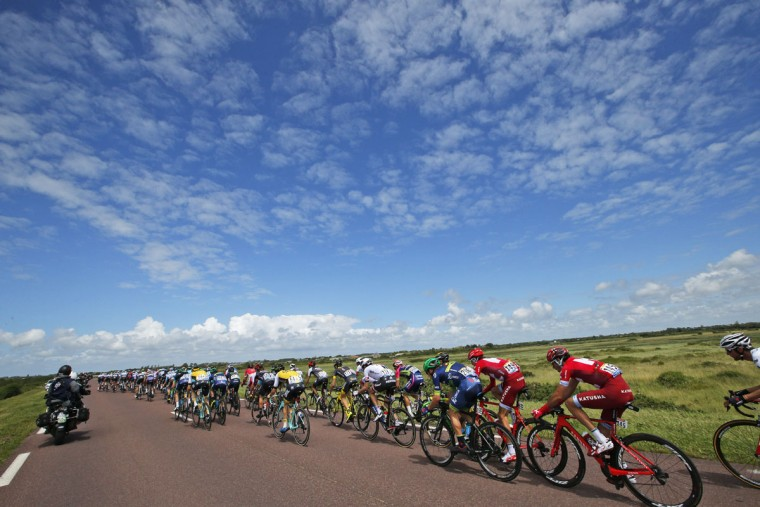The pack rides during the first stage of the Tour de France cycling race over 188 kilometers (116.8 miles) with start in Mont-Saint-Michel and finish in Utah Beach, France, Saturday, July 2, 2016. (AP Photo/Christophe Ena)