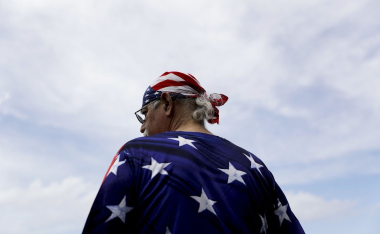 A supporter watches during a rally for Republican presidential candidate Donald Trump at Settlers Landing Park on Monday, July 18, 2016, in Cleveland. The Republican National Convention starts today. (AP Photo/Patrick Semansky)