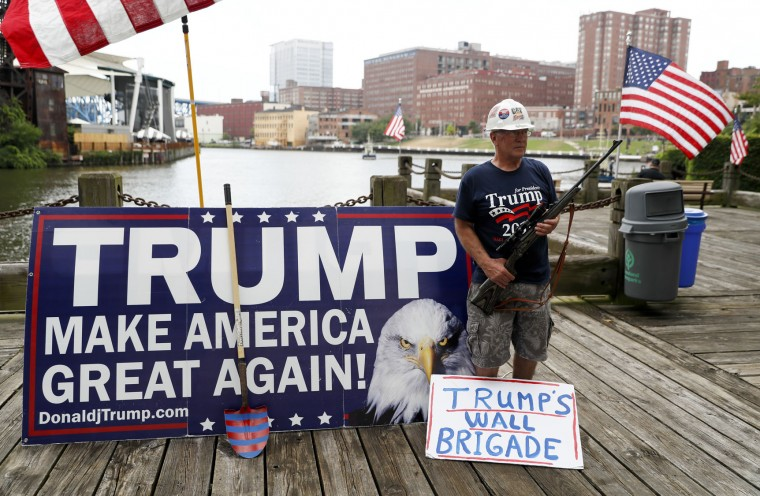Elan Stoltzfuz stands during a rally for Republican presidential candidate Donald Trump at Settlers Landing Park on Monday, July 18, 2016, in Cleveland. The Republican National Convention starts today. (AP Photo/John Minchillo)