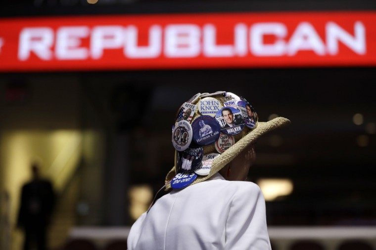 Judy Griffin of Cleveland shows off her button collection on her hat during first day of the Republican National Convention in Cleveland, Monday, July 18, 2016. (AP Photo/Matt Rourke)