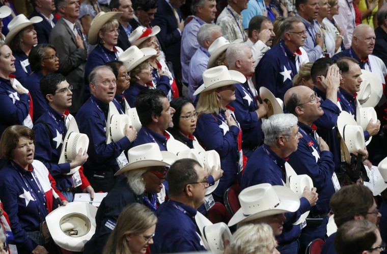 The Texas delegation says the Pledge of Allegiance during the opening day of the Republican National Convention in Cleveland, Monday, July 18, 2016. (AP Photo/Paul Sancya)