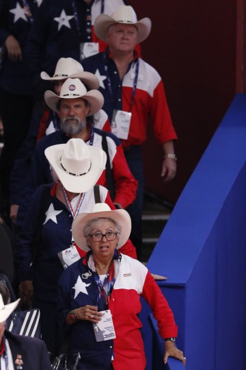 Members of the Texas delegation arrive for opening day of the the Republican National Convention in Cleveland, Monday, July 18, 2016. (AP Photo/J. Scott Applewhite)
