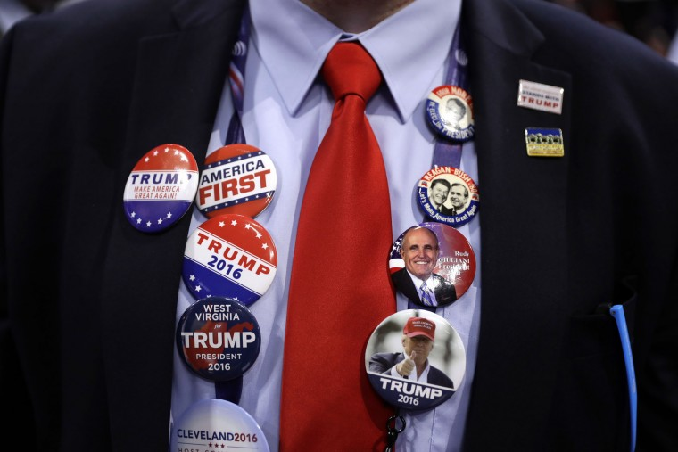 Caleb Turner from Hurricane, W.Va., shows off his button collections during first day of the Republican National Convention in Cleveland, Monday, July 18, 2016. (AP Photo/Matt Rourke)