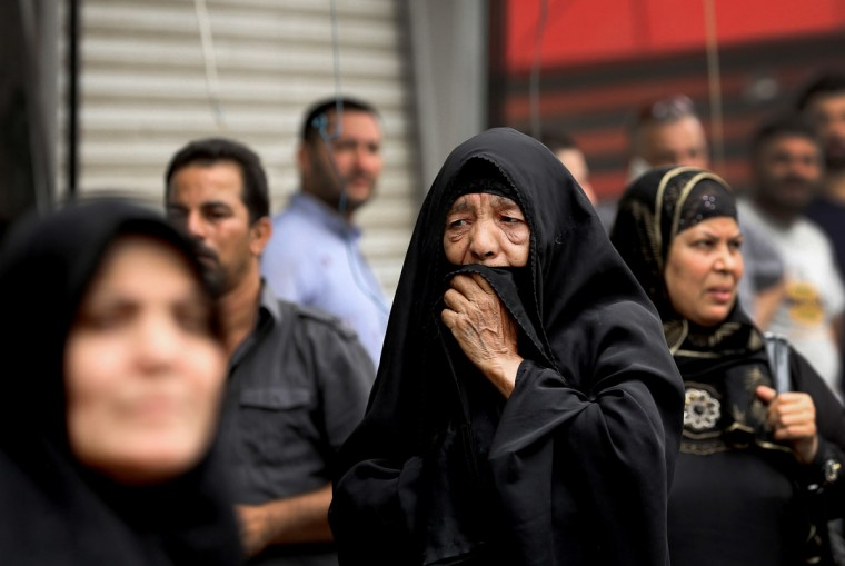 Iraqi women wait to hear about family members who went missing after a car bomb hit Karada, a busy shopping district in the center of Baghdad, Iraq, Sunday, July 3, 2016. Dozens of people have been killed and more than 100 wounded in two separate bomb attacks in the Iraqi capital Sunday morning, Iraqi officials said. (AP Photo/Hadi Mizban)