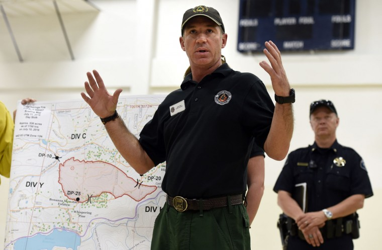 Rocky Mountain Incident Commander Shane Greer explains the current fire situation to evacuated residents during a community briefing regarding the Cold Springs Wildfire on Monday, July 11, 2016, at the Nederland High School in Nederland, Colo. (Jeremy Papasso/Daily Camera via AP)