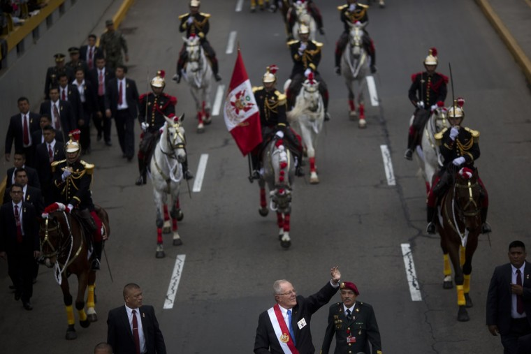 "Peru's President Pedro Pablo Kuczynski waves from an open-air vehicle during a military parade marking the country's Independence Day in Lima, Peru, Friday, July 29, 2016. Kuczynski assumed Peru's presidency Thursday telling Congress in his inaugural speech, ""I want Peru to be a beacon of civilization along the Pacific and in South America that everyone will look upon with admiration."" (AP Photo/Rodrigo Abd)"
