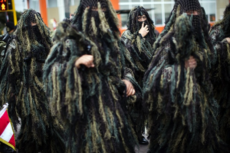 Soldiers dressed in their ghillie suits wait for the start of a military parade to mark the country's Independence Day in Lima, Peru, Friday, July 29, 2016. Peru declared it's independence from Spain on July 28, 1821. (AP Photo/Rodrigo Abd)