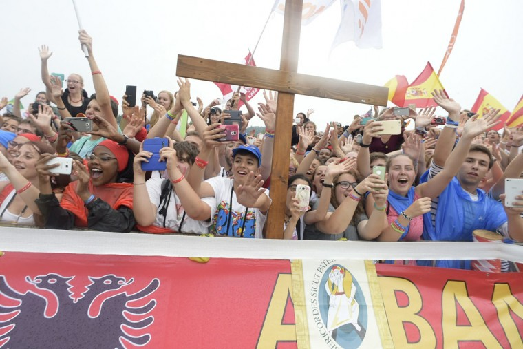 Faithful cheer as they welcome Pope Francis in Krakow's Jordan Park, Poland, on July 28, 2016, during the World Youth Days. (Osservatore Romano/Pool Photo via AP)