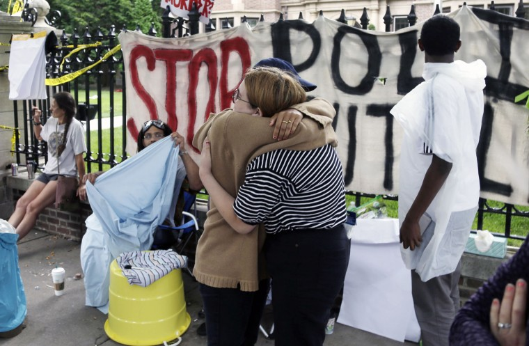 Two people embrace as demonstrators gather outside the governor's residence Friday, July 8, 2016, in St. Paul, Minn. where protests continue over the shooting death by police of Philando Castile after a traffic stop Wednesday, July 6, in Falcon Heights. (AP Photo/Jim Mone)