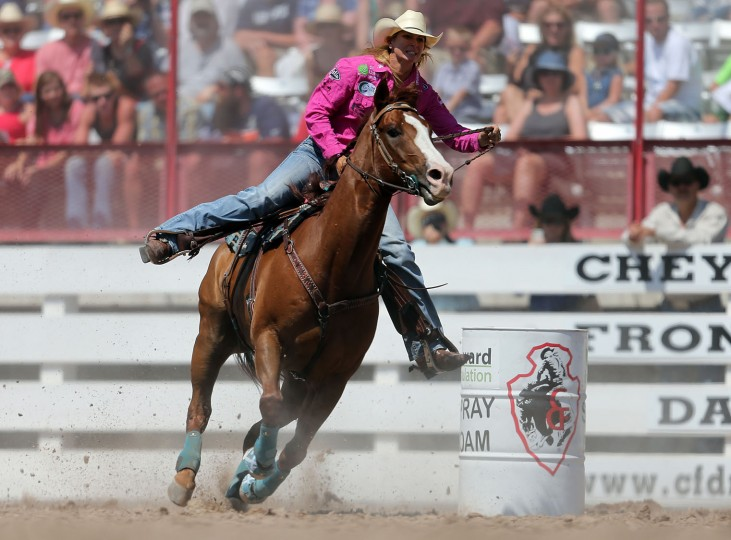 Sherry Cervi of Marana, Ariz., competes in the barrel racing event during the fifth performance of the 120th annual Cheyenne Frontier Days Rodeo Wednesday afternoon, July 27, 2016, at Frontier Park Arena in Cheyenne, Wyo. (Blaine McCartney/Wyoming Tribune Eagle via AP)