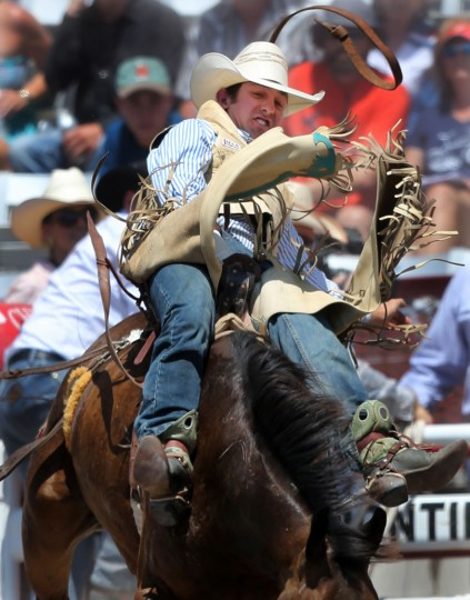 Levi Nicholson of Severance, Colo., competes in the bareback event during the fifth day of the 120th annual Cheyenne Frontier Days Rodeo Wednesday afternoon at Frontier Park Arena in Cheyenne, Wyo. (Blaine McCartney/Wyoming Tribune Eagle via AP)