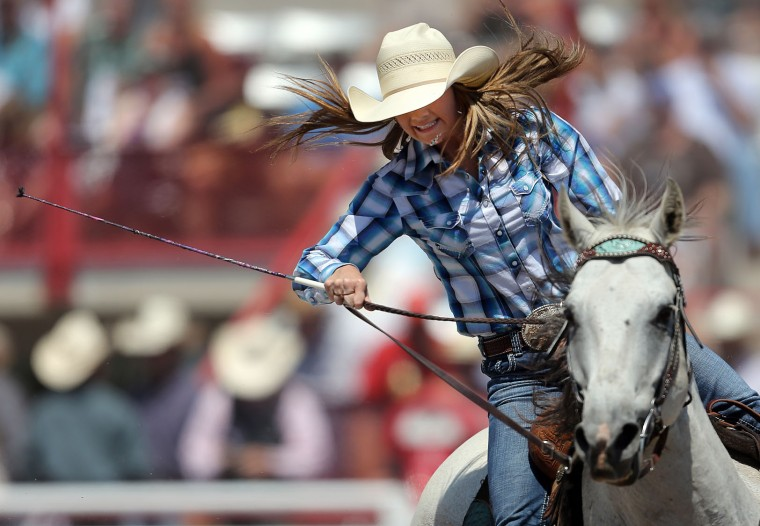 Kristi Steffes of Vale, S.D. rounds a barrel in the barrel racing event during the fifth performance of the 120th annual Cheyenne Frontier Days Rodeo Wednesday afternoon, July 27, 2016, at Frontier Park Arena in Cheyenne, Wyo. (Blaine McCartney/Wyoming Tribune Eagle via AP)