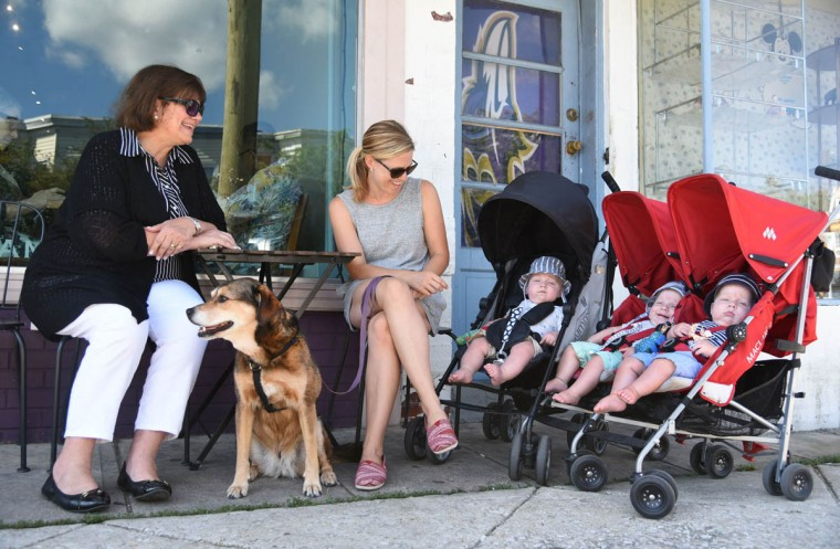Terry Hewitt, left, and her daughter-in-law, Kristen Hewitt, keep an eye on the triplets as they get drowsy at a Hampden cafe during a morning walk with the family dog, Jersey. (Amy Davis/Baltimore Sun)