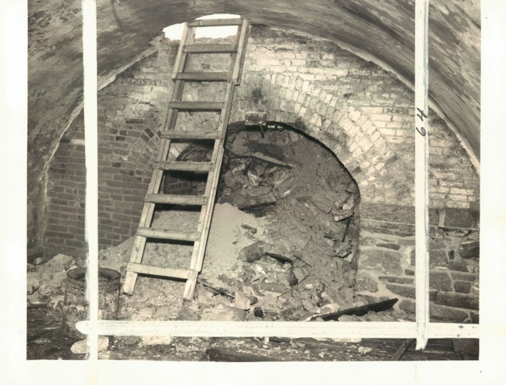 3-story deep vaults, along with a 100-foot tunnel were discovered underneath the Lexington Market parking area in 1951. These were later sealed off. (Baltimore Sun)