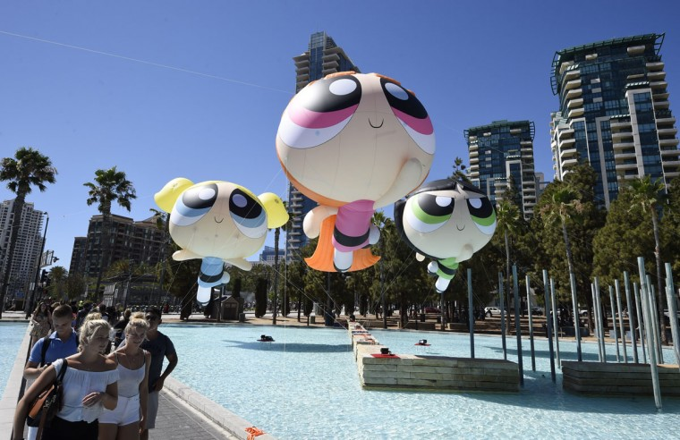 Fans walk past floating Cartoon Network Powerpuff Girls on day one of Comic-Con International held at the San Diego Convention Center Thursday, July 21, 2016, in San Diego. (Photo by Denis Poroy/Invision/AP)