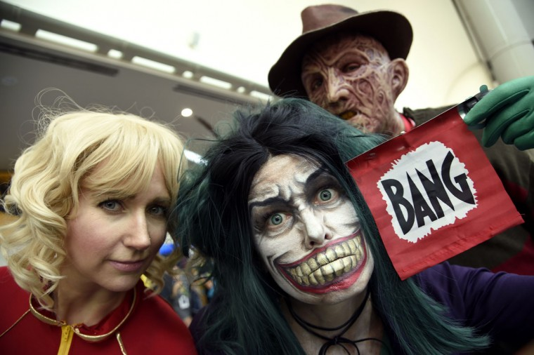 Fans dressed as Captain Marvel, from left, The Joker and Freddy Krueger attend day 1 of Comic-Con International on Thursday, July 21, 2016, in San Diego. (Photo by Chris Pizzello/Invision/AP)