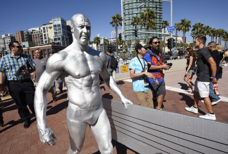 Todd Schimt, dressed as the Silver Surfer, carries his surfboard into the convention center on day one of Comic-Con International held at the San Diego Convention Center Thursday July 21, 2016, in San Diego. (Photo by Denis Poroy/Invision/AP)