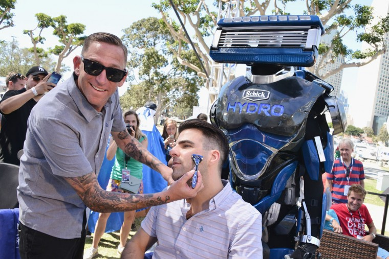 Actor Zachary Quinto hangs with San Diego barber Woody Donahue (left) and Robot Razor at the Schick Hydro Super Shave Shop at Entertainment Weeklys Con-X Fan Festival during Comic-Con, where he got a shave fit for a superhero on July 21, 2016 in San Diego, California. (Photo by Araya Diaz/Getty Images for Schick Hydro)