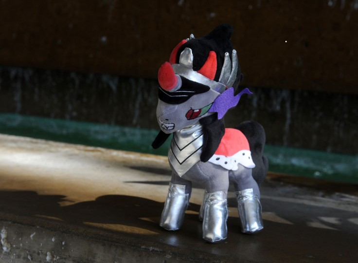 "Ian Darling's plush toy King Sombra stands ready for action in front of a fountain in the Baltimore Convention Center. Darling, from Colorado Springs, talks about the main antagonist in My Little Pony. ""He's my favorite,"" Darling said. BronyCon is the world's largest My Little Pony: Friendship is Magic convention. BronyCon features panels, meet-ups, activities, and cosplay. (Caitlin Faw/Baltimore Sun staff)"
