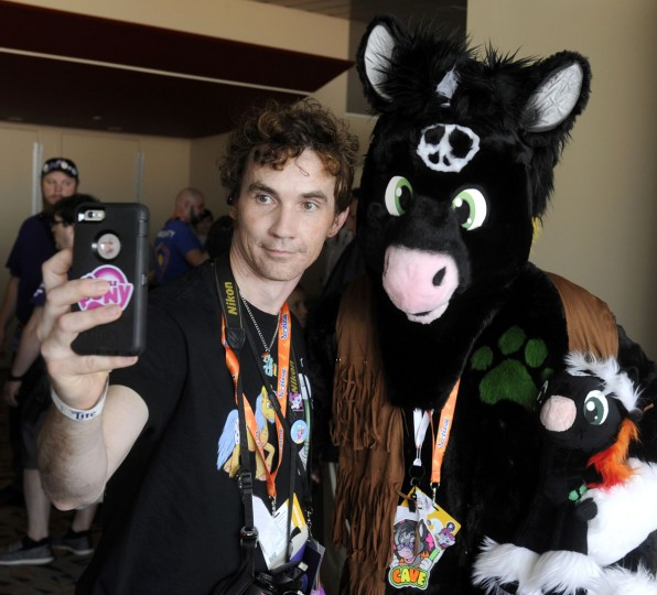 "John Price, left, of Omaha, Nebraska poses with Keith Faulkner of Ocoee, Florida, who dresses as an OC (original character). ""I have a good time,"" Price said. ""BronyCon reflects the goodness that should be in humanity."" BronyCon is the world's largest My Little Pony: Friendship is Magic convention. Held at the Baltimore Convention Center, BronyCon features panels, meet-ups, activities, and cosplay. (Caitlin Faw/Baltimore Sun staff)"