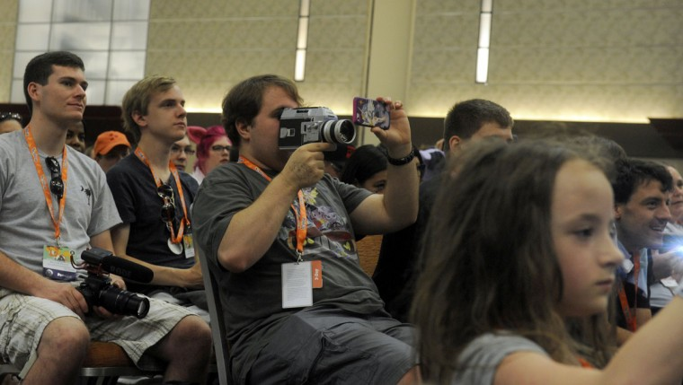 The crowd enjoys the Opening Ceremonies held in the Mane Event's Hall. BronyCon is the world's largest My Little Pony: Friendship is Magic convention. Held at the Baltimore Convention Center, BronyCon features panels, meet-ups, activities, and cosplay. (Caitlin Faw/Baltimore Sun staff)