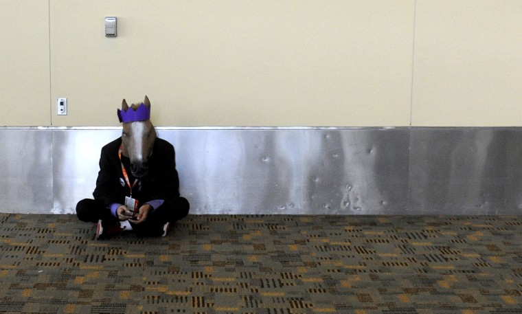 A person wearing a horse head mask sits in hallway of the Baltimore Convention Center. BronyCon is the world's largest My Little Pony: Friendship is Magic convention. BronyCon features panels, meet-ups, activities, and cosplay. (Caitlin Faw/Baltimore Sun staff)