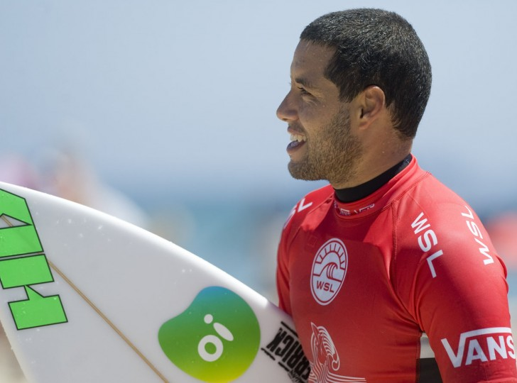 World champion surfer Adriano De Souza is all smiles after taking first place in round two of the U.S. Open of Surfing on Tuesday, July 26, 2016, in Huntington Beach, Calif. (Mindy Schauer/The Orange County Register via AP)