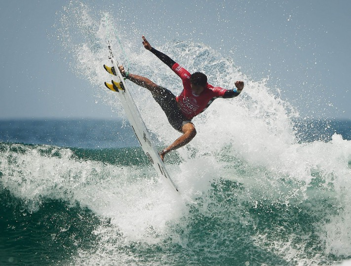 Joshua Moniz of Hawaii gets air in his men's heat during the first round of the US Open of Surfing at Huntington Beach, California on July 25, 2016. (MARK RALSTON/AFP/Getty Images)