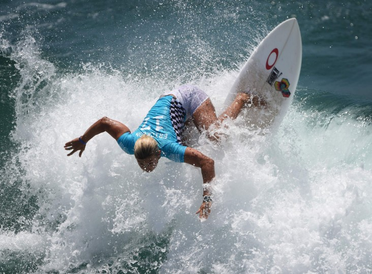 Sage Erickson of the US surfs en route to winning her women's heat in the first round of the US Open of Surfing at Huntington Beach, California on July 25, 2016. The event celebrates its 57th year beside the historic Huntington Pier, which is considered the birthplace of California's surfing culture. (MARK RALSTON/AFP/Getty Images)