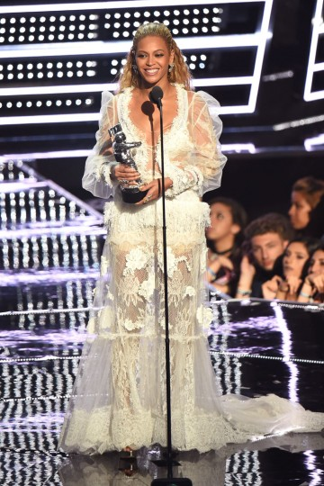 """Beyonce accepts the award for """"Video of the Year"""" onstage during the 2016 MTV Video Music Awards at Madison Square Garden on August 28, 2016 in New York City. (Photo by Michael Loccisano/Getty Images)"""