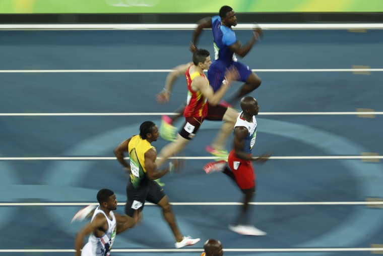 (From top) USA's Justin Gatlin, Spain's Bruno Hortelano, Panama's Alonso Edward, Jamaica's Yohan Blake and Britain's Nethaneel Mitchell-Blake compete in the Men's 200m Semifinal during the athletics event at the Rio 2016 Olympic Games at the Olympic Stadium in Rio de Janeiro on August 17, 2016. (Odd Andersen/AFP/Getty Images)