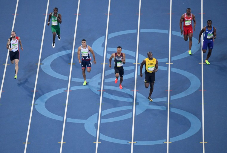(FromL) Turkey's Ramil Guliyev, Nigeria's Ejowvokoghene Oduduru, Britain's Adam Gemili, Canada's Andre De Grasse, Jamaica's Usain Bolt, Bahrain's Yaqoob Salem Eid Yaqoob and USA's Ameer Webb compete in the Men's 200m Semifinal during the athletics event at the Rio 2016 Olympic Games at the Olympic Stadium in Rio de Janeiro on August 17, 2016. (Antonin Thuillier/AFP/Getty Images)