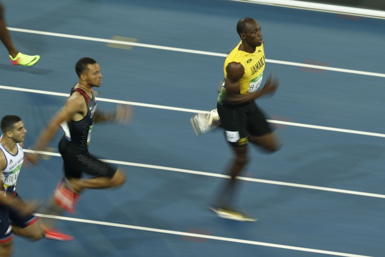 Jamaica's Usain Bolt (R) competes with Canada's Andre De Grasse (C) and Britain's Adam Gemili in the Men's 200m Semifinal during the athletics event at the Rio 2016 Olympic Games at the Olympic Stadium in Rio de Janeiro on August 17, 2016. (Odd Andersen/AFP/Getty Images)