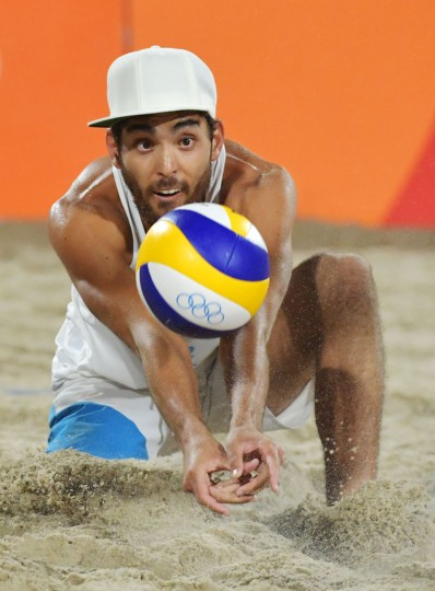 Italy's Daniele Lupo plays a shot during the men's beach volleyball final match between Italy and Brazil at the Beach Volley Arena in Rio de Janeiro late on August 18, 2016, for the Rio 2016 Olympic Games. (Yasuyoshi Chiba/AFP/Getty Images)