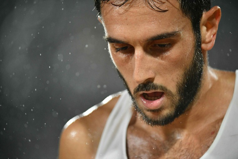 Italy's Paolo Nicolai reacts during the men's beach volleyball final match between Italy and Brazil at the Beach Volley Arena in Rio de Janeiro late on August 18, 2016, for the Rio 2016 Olympic Games. (Leon Neal/AFP/Getty Images)