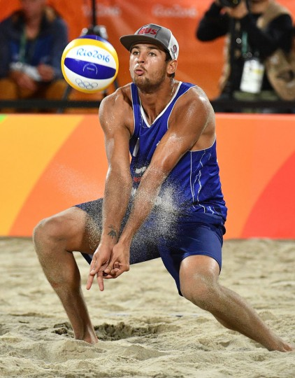 Russia's Viacheslav Krasilnikov controls the ball during the men's beach volleyball bronze medal match between Russia and the Netherlands at the Beach Volley Arena in Rio de Janeiro on August 18, 2016, for the Rio 2016 Olympic Games. Leon Neal/AFP/Getty Images)