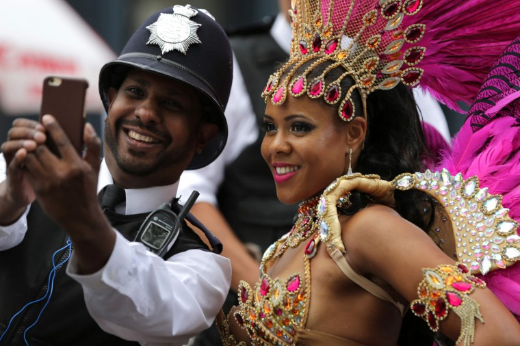 A performer poses for a selfie with a policeman on the second day of the Notting Hill Carnival in west London on August 29, 2016. Nearly one million people are expected by the organizers Sunday and Monday in the streets of west London's Notting Hill to celebrate Caribbean culture at a carnival considered the largest street demonstration in Europe. (Daniel Leal-Olivas/AFP/Getty Images)