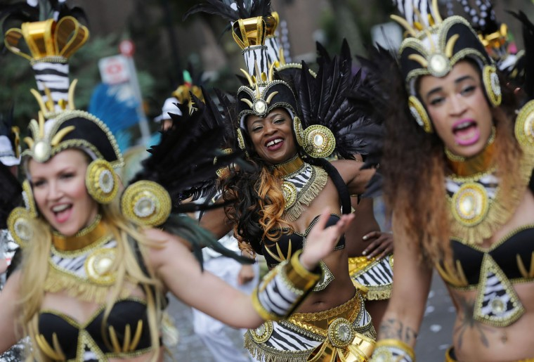 Performers in costume parade on the second day of the Notting Hill Carnival in west London on August 29, 2016. Nearly one million people are expected by the organizers Sunday and Monday in the streets of west London's Notting Hill to celebrate Caribbean culture at a carnival considered the largest street demonstration in Europe. (Daniel Leal-Olivas/AFP/Getty Images)