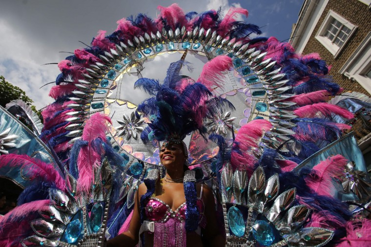 Performers pose on the second day of the Notting Hill Carnival in west London on August 29, 2016. Nearly one million people are expected by the organizers Sunday and Monday in the streets of west London's Notting Hill to celebrate Caribbean culture at a carnival considered the largest street demonstration in Europe. (Daniel Leal-Olivas/AFP/Getty Images)