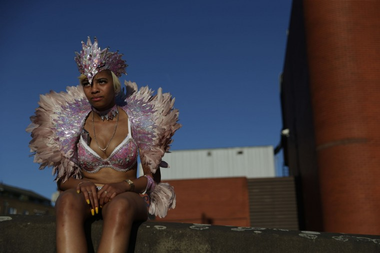 A performer sits on a wall at the end of the second day of the Notting Hill Carnival in west London on August 29, 2016. Nearly one million people are expected by the organizers Sunday and Monday in the streets of west London's Notting Hill to celebrate Caribbean culture at a carnival considered the largest street demonstration in Europe. (Daniel Leal-Olivas/AFP/Getty Images)