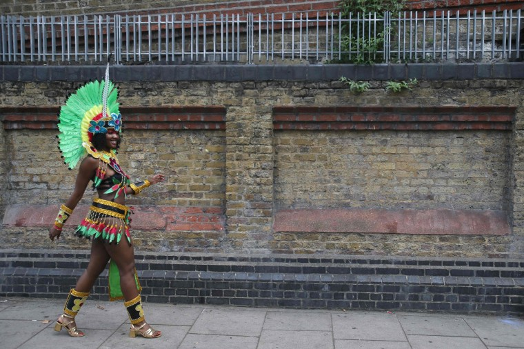 A performer walks down a street on the second day of the Notting Hill Carnival in west London on August 29, 2016. Nearly one million people are expected by the organizers Sunday and Monday in the streets of west London's Notting Hill to celebrate Caribbean culture at a carnival considered the largest street demonstration in Europe. (Daniel Leal-Olivas/AFP/Getty Images)