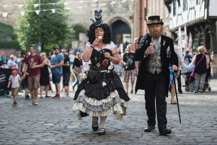 Steampunk enthusiasts attend the first day of 'The Asylum Steampunk Festival' in Lincoln, northern England on August 26, 2016. The four-day alternative lifestyle festival is the largest and longest running steampunk festival in the World; combining art, literature, music, fashion and comedy. Steampunk is a subgenre of science fiction or science fantasy that incorporates technology and aesthetic designs inspired by 19th-century industrial steam-powered machinery. / (AFP Photo/Oli Scarff)