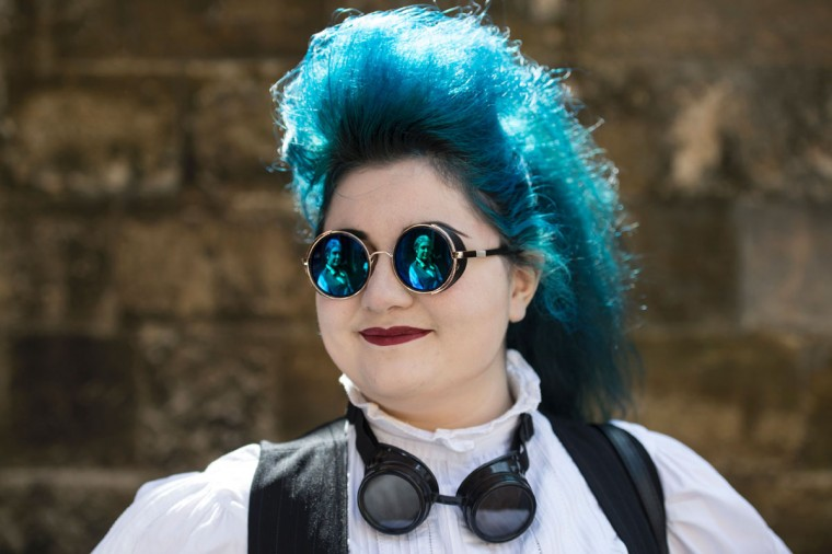 A Steampunk enthusiast attends the first day of 'The Asylum Steampunk Festival' in Lincoln, northern England on August 26, 2016. The four-day alternative lifestyle festival is the largest and longest running steampunk festival in the World; combining art, literature, music, fashion and comedy. Steampunk is a subgenre of science fiction or science fantasy that incorporates technology and aesthetic designs inspired by 19th-century industrial steam-powered machinery. / (AFP Photo/Oli Scarff)